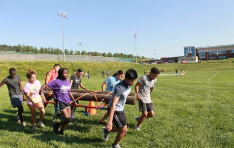 Members of JROTC take part in Raider camp as they go through an obstacle course.