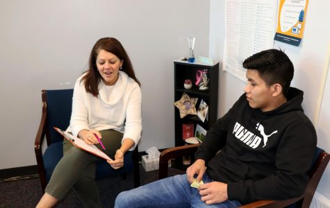 Counselor Brino schedules junior Yonker Vasquez Lopez for next years classes.