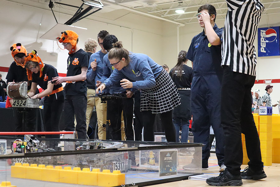 Team Error 404 starts their hands-on portion of one of their matches. This follows the 30 second autonomous period where team members cannot touch the controller.