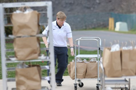 HHS principal Melissa Hensley rolls bagged food to give to families during the COVID-19 lockdown.