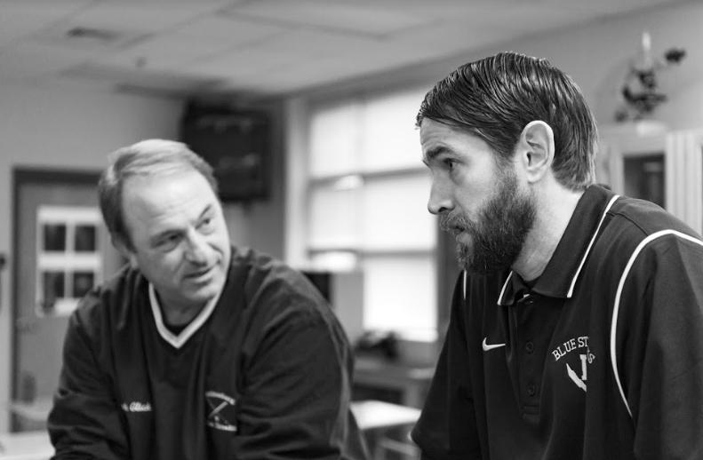 Assistant principal Joe Glick (left) talks to science teacher Gehrie Blair.