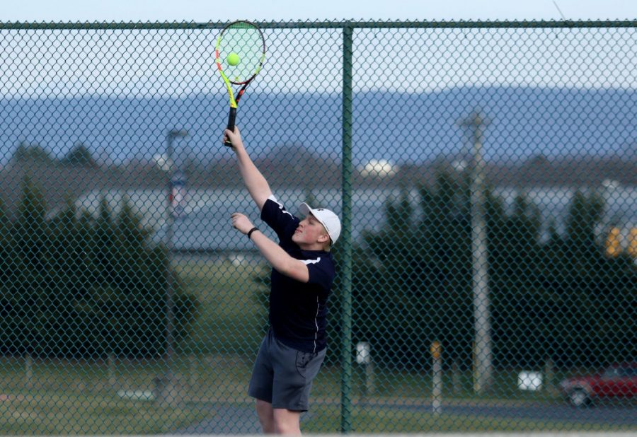 Sophomore+Adam+Osinkosky+serves+the+ball+in+his+match+as+the+three+seed+against+Fort+Defiance.+The+end+score+for+this+match+was+10-4+Harrisonburg.+