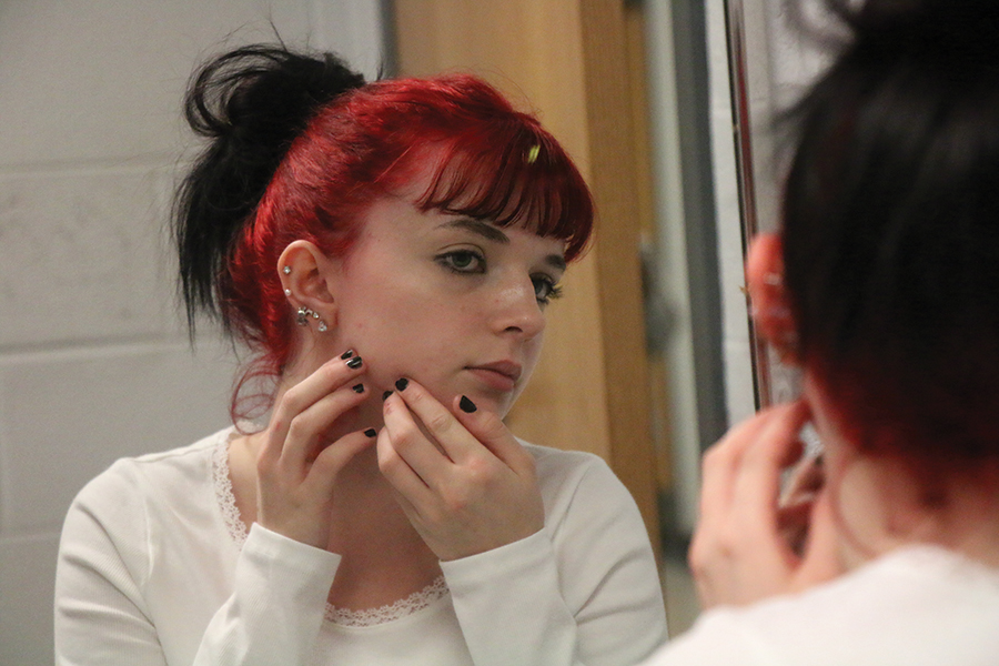 Sophomore Kolbie Czajkowski inspects her skin. Czajkowski has her own skin care routine that she has followed and has found it to help her skin.