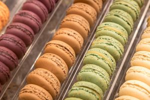 Macarons in the display of a chocolate shop. They may be pretty to look at, but once you bite into them, macarons are flakey and actually have very little taste.
