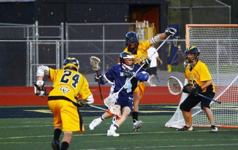 A high school lacrosse team competes in a game. Lacrosse isn't commonly offered as an extracurricular school sport in this area of Virginia.