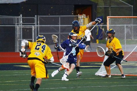A high school lacrosse team competes in a game. Lacrosse isn