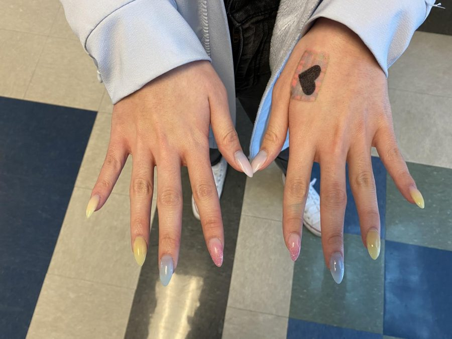 Junior Emily Nguyen enjoys different colored nails like this set. She likes to be creative and enjoys the way acrylics make her feel more confident about herself.