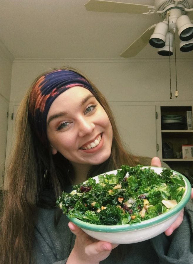 In order to maintain a healthy lifestyle during quarantine, senior Kate Cummings makes a Grilled Kale and Fruit Salad recipe for dinner.