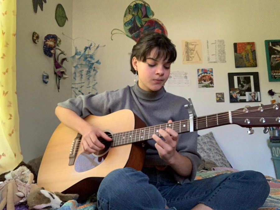 12 p.m. Twining practices and plays her guitar.