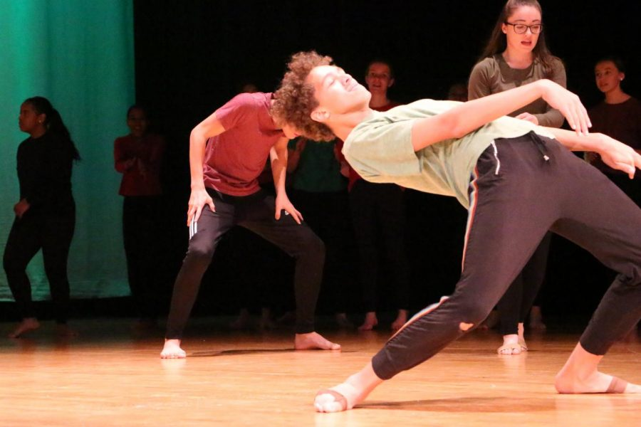Junior+Javion+Green+dances+on+stage+in+the+auditorium.+Green%27s+favorite+type+of+dance+is+modern.