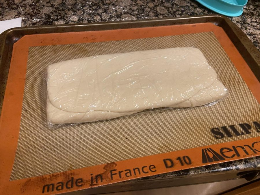 Fold the square of dough into thirds and wrap with the plastic wrap, then chill the dough- this will prevent the butter from melting during the next steps. You can also choose to freeze your dough at this point for it to be used at a later date.