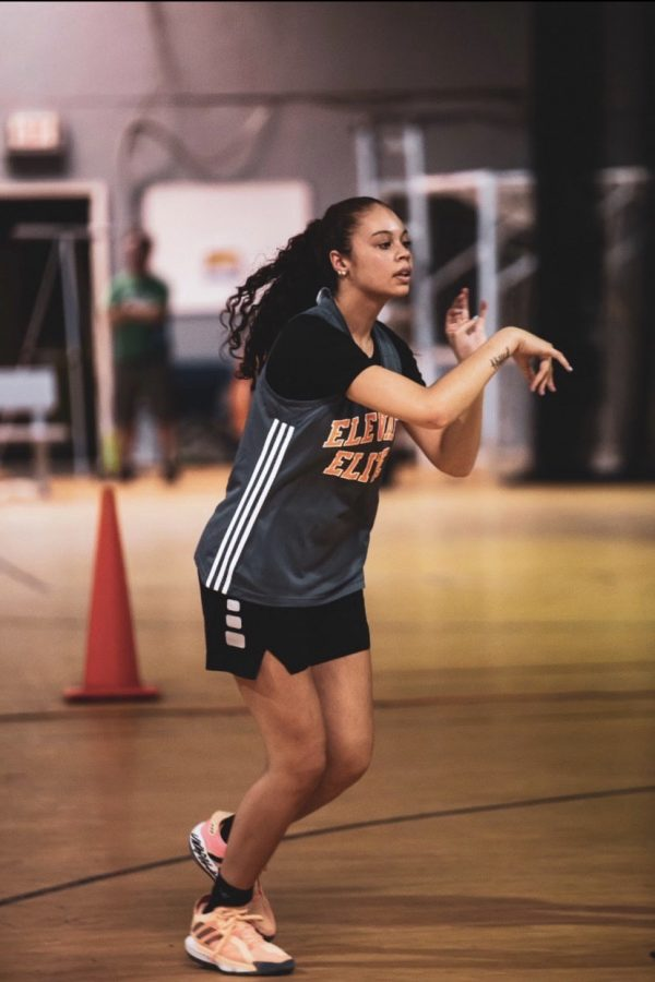 Cain looks to pass the ball during a practice for the team she plays on outside of school, Elevate Elite.
