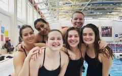 Fox (second from right) with her teammates during a swim meet.