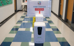 Hand sanitizing stations are set up throughout schools to prevent the spread of COVID-19.