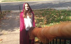 Freshman Anna Campillo dressed as Little Red Riding Hood for Halloween. Campillo and her family created a tube to send candy to trick or treaters to stay safe.