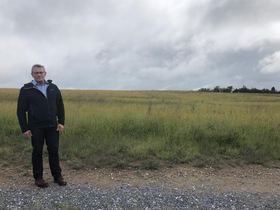 Swayne stands in front of the land where HHS 2 will be built.