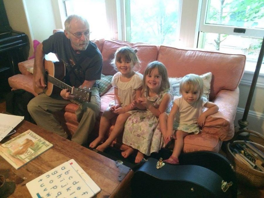 Peckham (left) sings to his grandchildren.