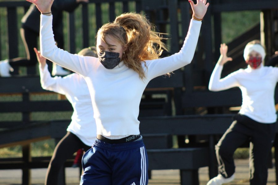 Junior Laura González Dutor jumps during a dance move.