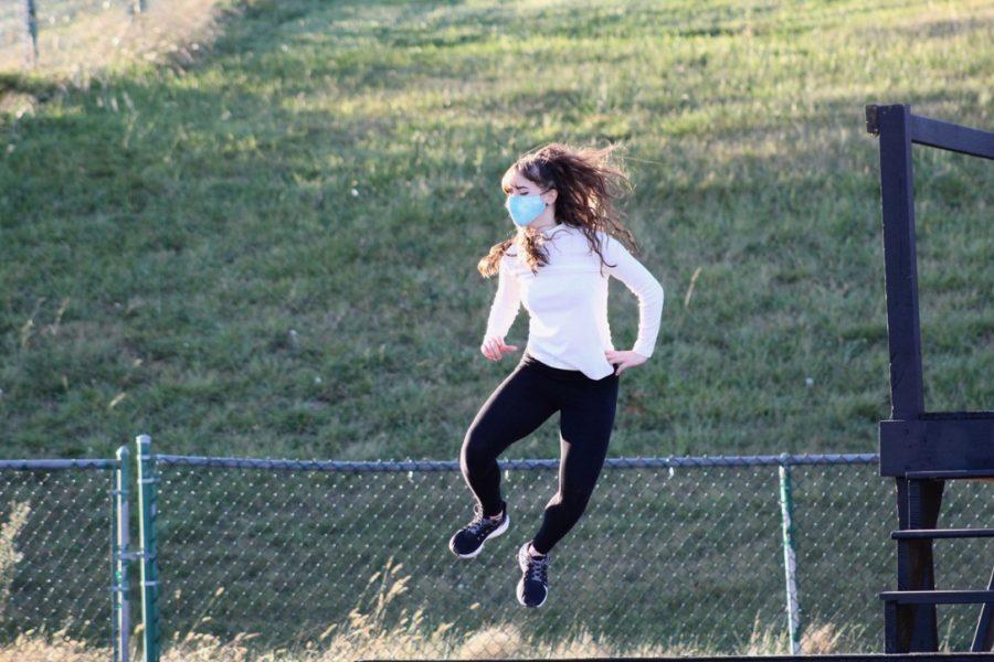 Sophomore Kate Nichols jumps during a dance.