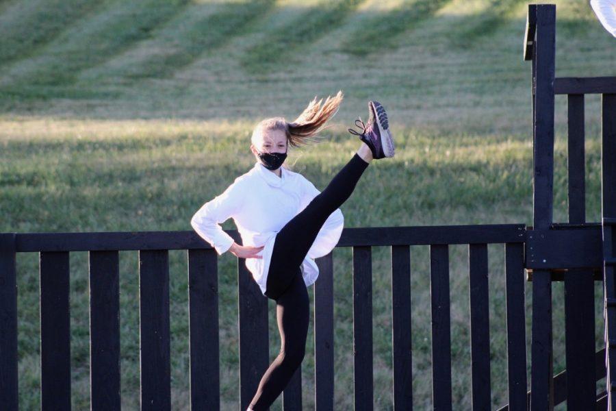 Freshman Natalie Corso kicks during a dance.