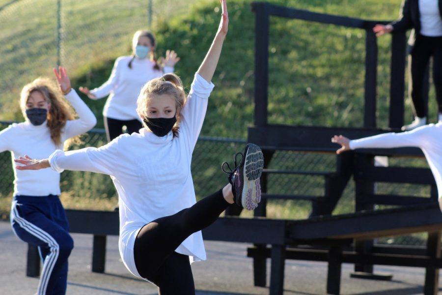 Freshman Natalie Corso kicks while dancing during rehearsal.