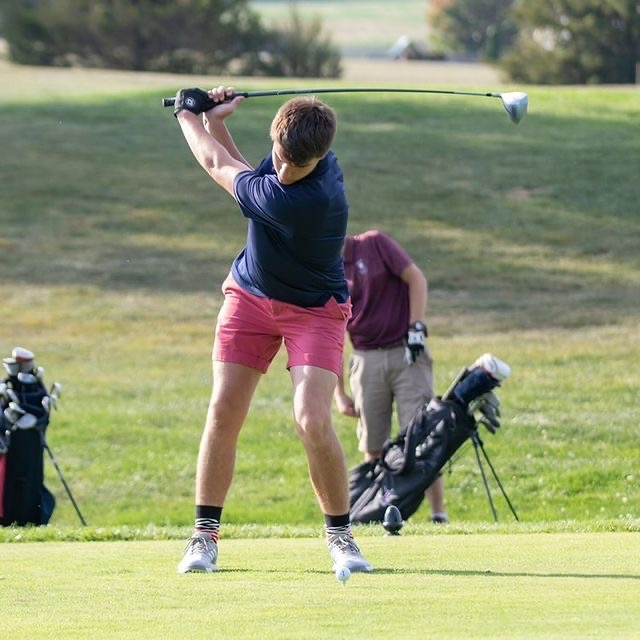Brown tees off at a golf tournaments during last year's high school golf tournament. Brown decided to pursue golf because it proved little to no risk for another concussion.