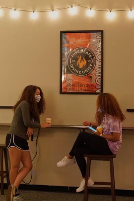 Junior Alexis Moats and Kacie Boone sit at the Fused Cafe.