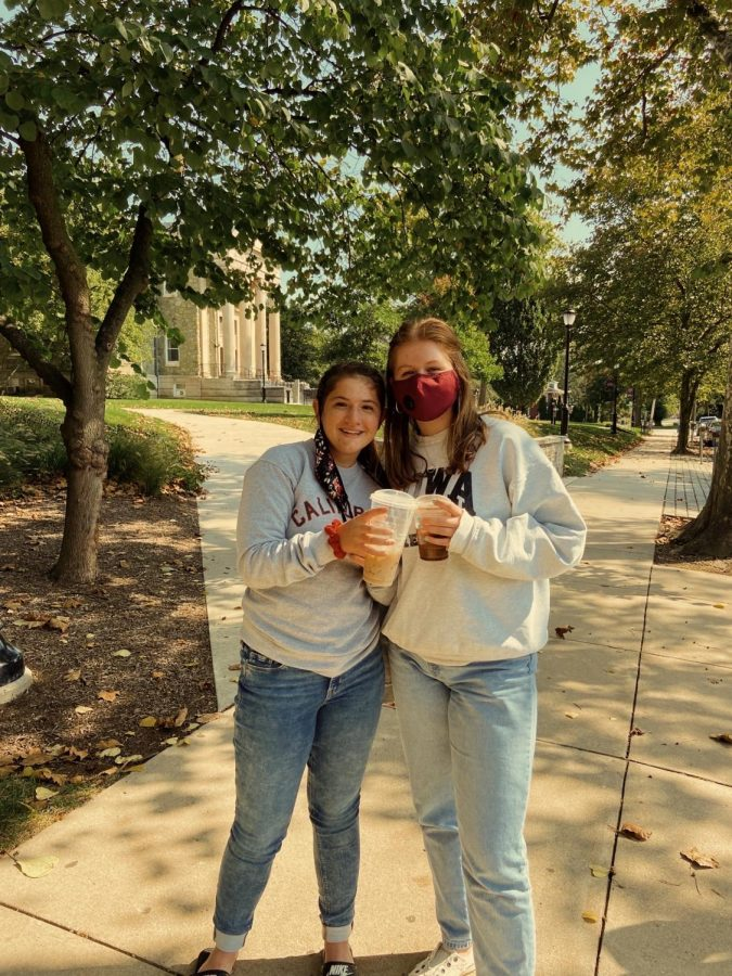 Brino-Dean poses with her sister, sophomore Tylor Brino-Dean, in front of one of the six colleges she toured.