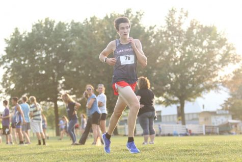 Beck runs to the finish line during one of his first races of his 2019-2020 season.