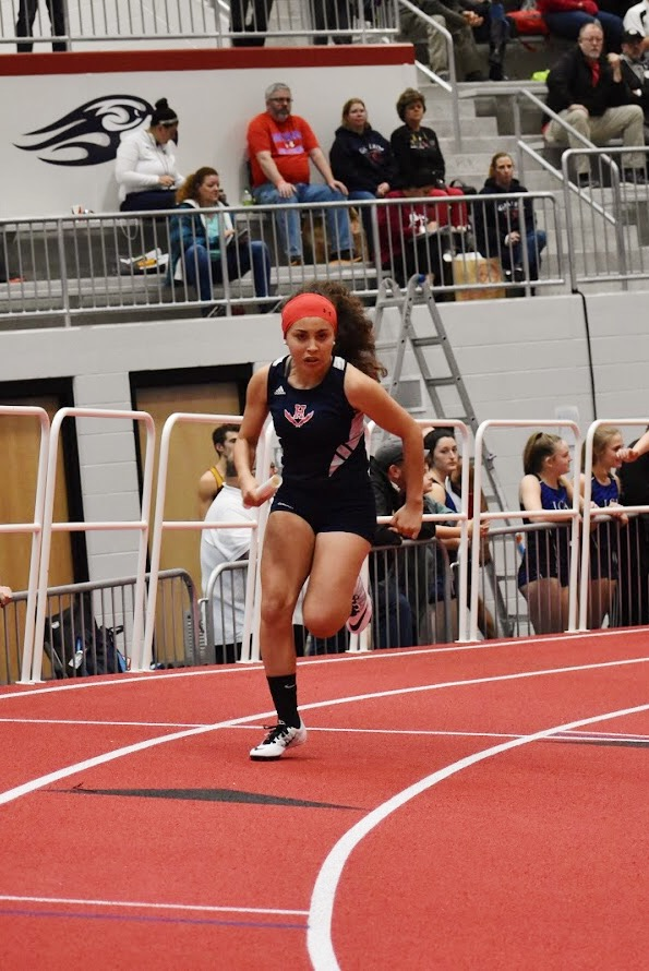 Acosta-Iscoa begins a relay during the 2020 season.