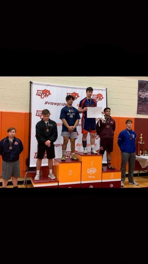 Senior Blake Metcalf stands atop the podium after winning the Mountain View tournament.