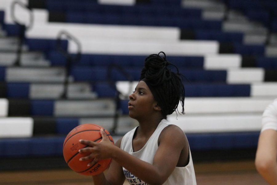Senior Calayiah Stuart preparing to shoot during one of her basketball practices during junior year.