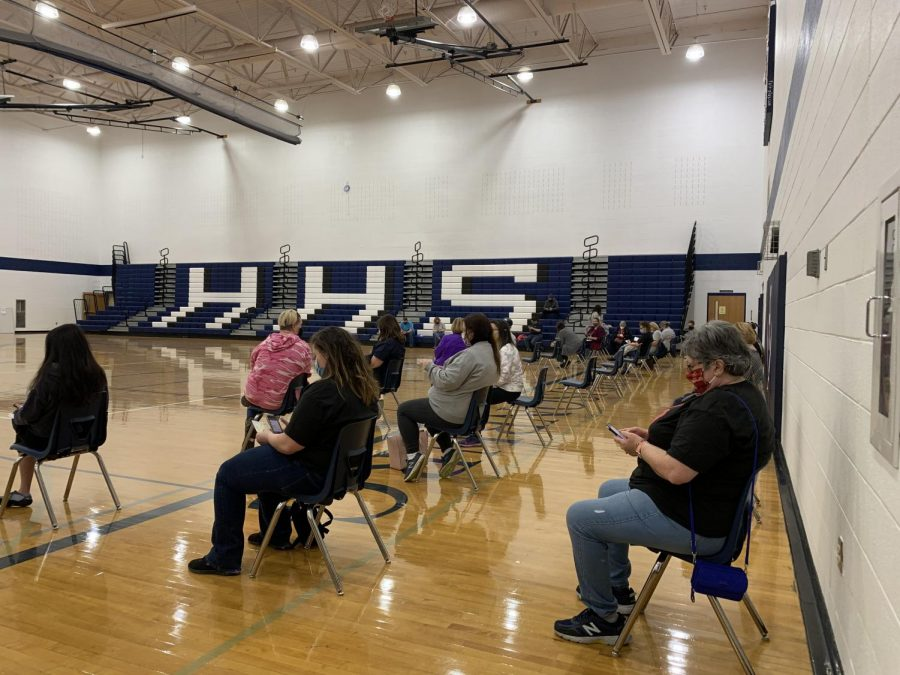 HCPS teachers and staff wait in the gymnasium of Harrisonburg High School for their vaccination.