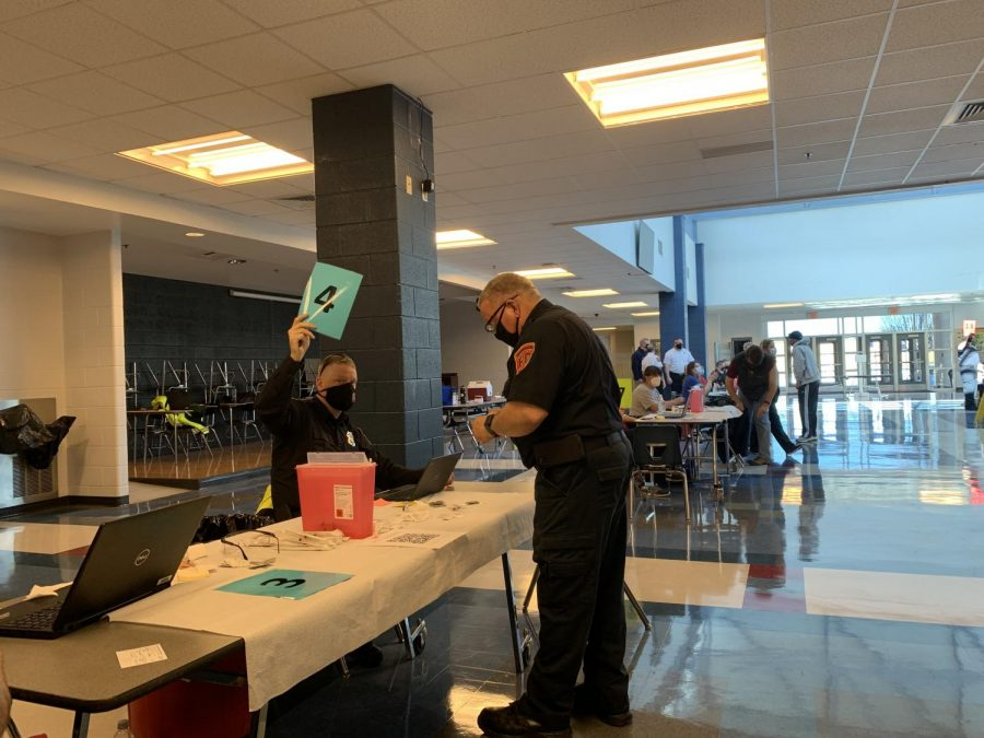 HCPS staff arrive in the gymnasium commons to get their COVID-19 vaccine.