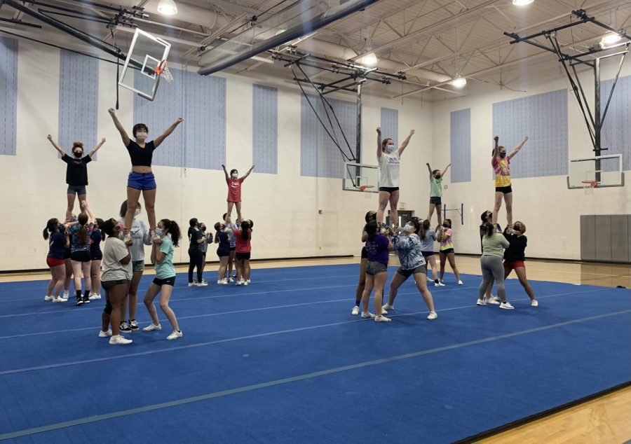 Both underclassmen and returning athletes stunt during the last day of competition cheer tryouts.