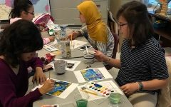 French Club members from a previous school year paint Van Gogh pieces together.