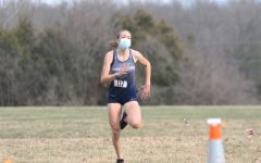 Freshman Annie Poirot  sprints towards the finish line at a home meet at THMS.