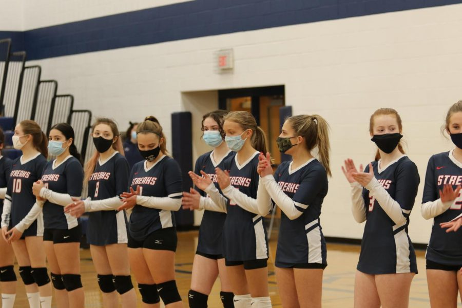 The JV Volleyball team lines up before their match against Turner Ashby March 2.