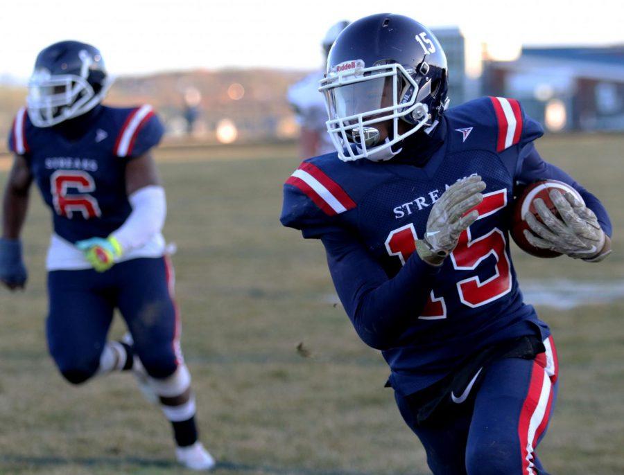 Chacon runs the ball down the field.