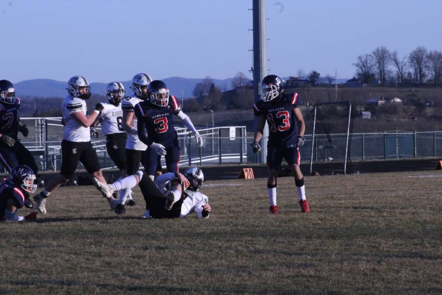 Turner Ashby player receives the ball, but falls on the ground after making a big jump for it.