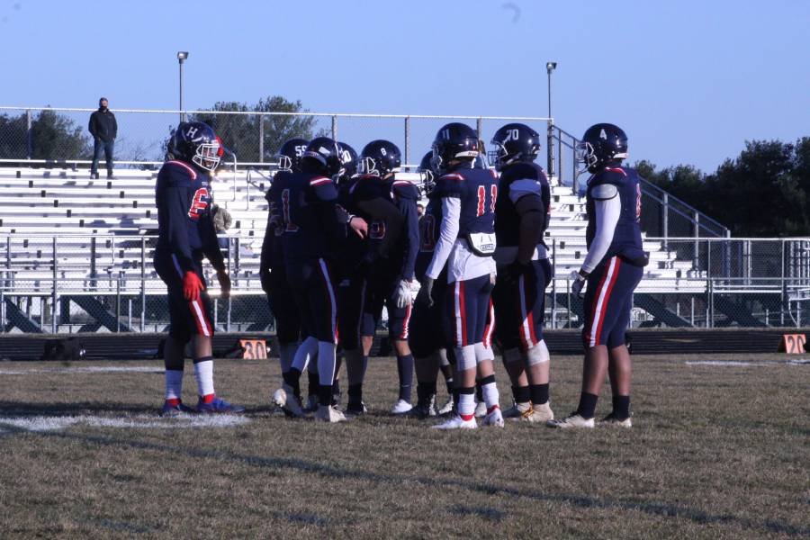 HHS varsity football team gets together to discuss strategies against Turner Ashby.