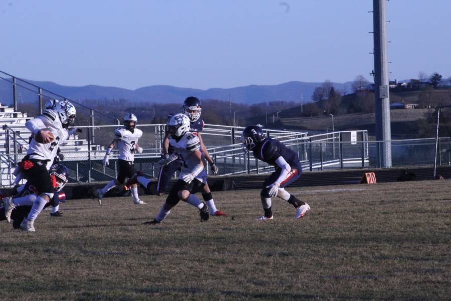 A Turner Ashby player receives the ball and tries to carve his way deeper into the touchdown area.