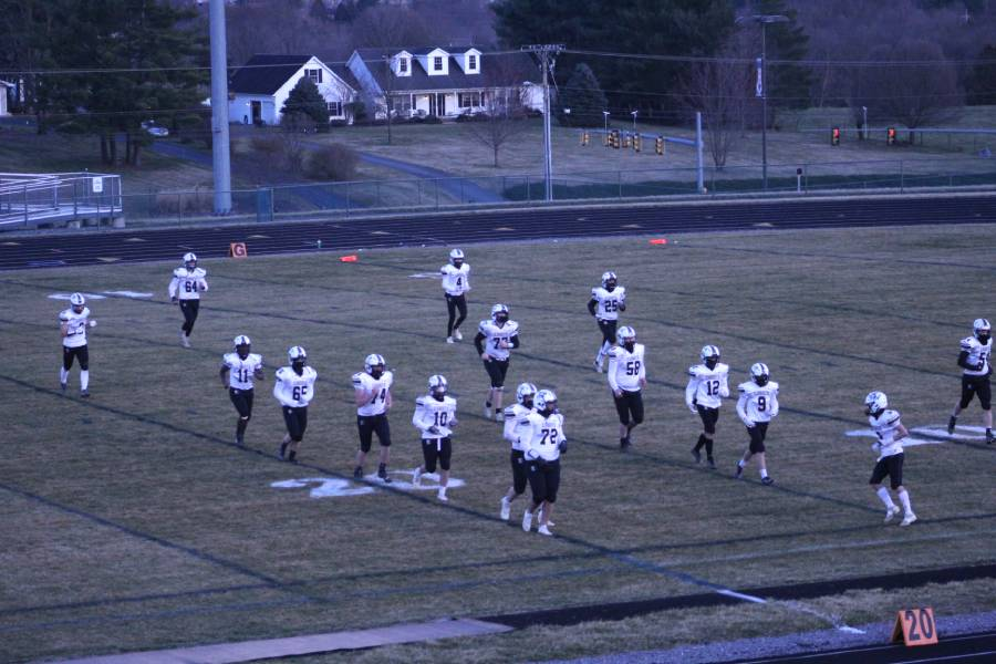 The Turner Ashby varsity football team enters the football field after the twelve minute halftime, ready to do their best on the field before the game ends