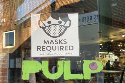 Like many other stores downtown, Shenandoah Bicycle Company has signs out front letting customers know they have to wear a mask in the store.