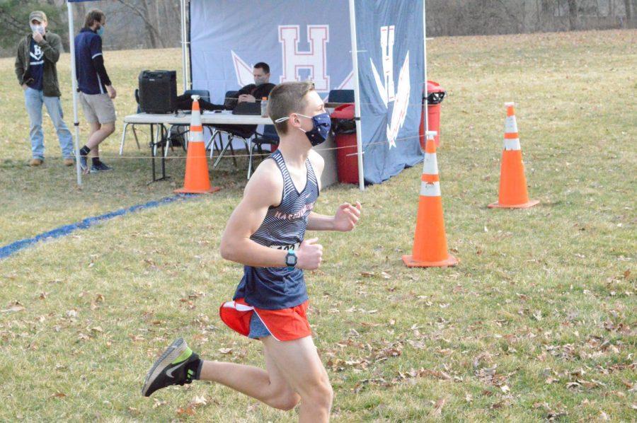 Freshman Nathaniel Bunn runs.