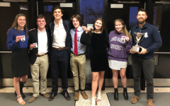 The HHS debate team stands holding their medals alongside coach Aaron Cosner after their regionals competition. The competition was held at Turner Ashby High School. This photo was taken before lockdown from the pandemic was set.