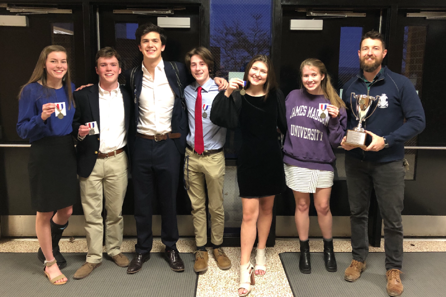 The+HHS+debate+team+stands+holding+their+medals+alongside+coach+Aaron+Cosner+after+their+regionals+competition.+The+competition+was+held+at+Turner+Ashby+High+School.+This+photo+was+taken+before+lockdown+from+the+pandemic+was+set.+