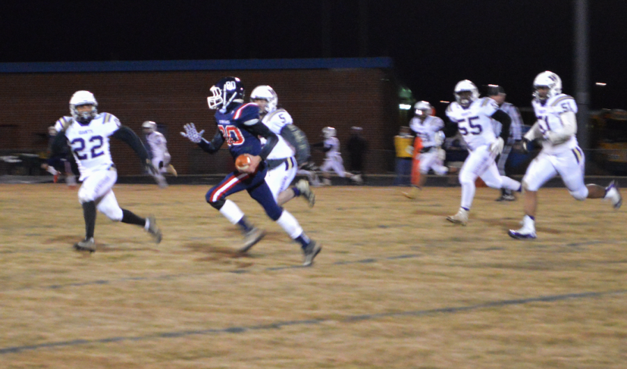 Sophomore Jadon Burgess, number 80, runs with the ball.