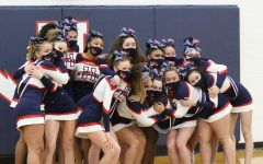 The HHS Competition Cheer team posing together after their competition on March 17, 2021.