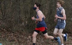 Sophomore Liam Wightman runs during a cross country meet at Thomas Harrison Middle School on March 17, 2021.